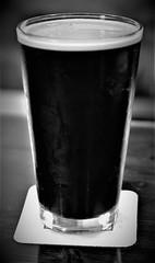Oatmeal Stout in Black and White (rabidscottsman) Tags: scotthendersonphotography stout oatmealstout beer darkbeer brewery chapelbrewing mn minnesota dundasminnesota ricecountyminnesota alcohol alcoholicbeverage adultbeverage weekend 35mm nikon nikond7100 d7100 nikkor nikkor35mmf18 nitro glass beerglass delicious coaster saturday blackandwhite bw exploreminnesota socialmedia usa unitedstatesofamerica