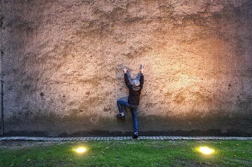 Climbing a wall.
