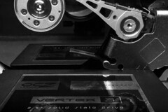 EVOLUTION HARD DISK DRIVE x SOLID STATE DRIVE (Mark Photography 2017) Tags: angle artificial black bw close closeup communications composition computer computing crafts data deep detail disk drive flash focus format frame framing freeze front gear genre hard hd horizontal image indoor interior landscape lens lenses light lighting macro macromondays mondays motion object ocz orientation photo photography setting solid ssd state storage style treatment up vertex view whiteartscraftsphotographytreatmentimagetypeblackwhitebamdwbwsettinginteriorindoorphotogenrestylemacromondaysmacromondaysgearlenslensesorientationlandscapemotionfreezeframelightingflashlightartificialframingcompositionde removedfromstrobistpool nostrobistinfo seerule2