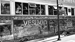 Vesuvio Cafe - 2 (draketoulouse) Tags: san francisco sanfrancisco northbeach kerouacalley kerouac beats burroughs mural street streetphotography people blackandwhite monochrome bar tavern window reflection city urban sunlight shadow