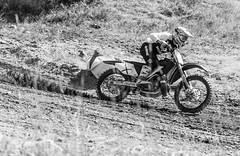 Accelerating Past The Weeds (John Kocijanski) Tags: motorcycle motocross moto race rider circles odc blackandwhite sport canon70300mmllens canon7d people