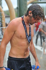 Mud in the Ear (Chris Hunkeler) Tags: shirtless male man athlete wet marinecorpsmudrun bare chest barechested curly hair
