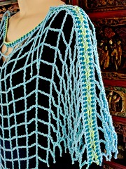 Aquarienne side lacing (vashtirama) Tags: lacing laced convertible poncho wrap shawl p2p pointtopoint crochetpattern crochetbeachcoverup beads dvpublished lotus summer tunisian hires filet colorwork filter seamfinishing cornerstart tunisiancrochetlace triangle shaped vest lacytunisiancrochet tallstitch beach mermaidy coverup drape mesh net tunisiancrochet filetcrochet lace lacy designingvashtilotusyarn lacingcrochet patterndownloadablepdfmydesign vashtiyarn dorischanyarn beaded seedbeads fringe twistedfringe beadedfringe triangular sidetoside s2s vneck bateau crochetlinenstitch crochetmossstitch crochetseedstitch crochetponcho beachponcho