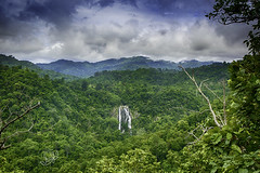 The most famous Khlonglan waterfall in deep forest top view in mountains with cloud and sky. (kritsayamachin) Tags: asia thailand waterfall nature natural water view fall travel landscape mountainwaterfall white outdoor rock river waterfallmountain mountain tourism flow blue beautiful background forest horizontal green fresh motion exotic famous clouds park unesco tropical vacation wet wonder wild rainforest jungle national navigation beauty close summer waterfallnature adventure stone sky high outdoors