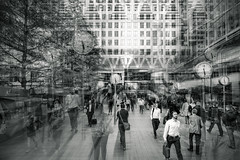 Rush (Мaistora) Tags: rush hurry busy walk go run crazy beehive people motion dynamic race rat rut bank finance business city canarywharf canadasquare canadawater offices towers plazas skyscrapers markets money economy time timepieces clocks street square passage alley cafe bar restaurant rushhour day working hours eob cob bw blackandwhite mono monochrome blur radial zoom layer layered lightroom photoshop film paper analog analogue silver grain contrast