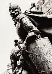 Figure (Krakow Monument) Olympus OM-D EM1-II & M.Zuiko 12-100mm f4 Travel-Zoom (markdbaynham) Tags: monument statue krakow cracow poland polish polen oldtown pl olympus omd em1 em1ii em1mk2 csc mirrorless m43 m43rd micro43 micro43rd mzd zd mz mzuiko 12100mm f4 travelzoom bw blackwhite monochrome