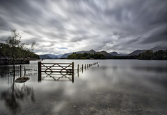 SERENE but is it............... (lynneberry57) Tags: derwentwater lakedistrict cumbria lake clouds serene tree grey water reflections gate canon 70d leebigstopper leefilters nature light