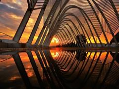 Amazing sunset (Artemios Karavas) Tags: athens artemiosphotos attica water sky sunset sunny street streetphotography town exploration reflections red rain urban building industeial greece clouds cloudscape colors city