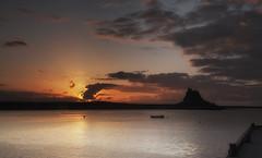 Sunrise at the Rock (Elidor.) Tags: lindisfarne holyisland northumberland berwickupontweed northeast dawn sunrise clouds castle history morning d90