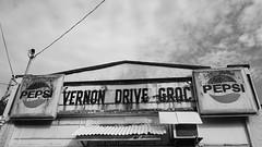 """Vernon Drive Grocery"" (Eric Flexyourhead) Tags: vancouver canada britishcolumbia bc strathcona vernondrive city urban street shop store cornershop cornerstore vernondrivegrocery old weathered worn patina sign pepsi monochrome blackwhite bw 169 sonyalphaa7 sonyfe28mmf2 28mmf2"