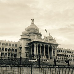 The iconic spectacle that bengaluru identifies with (paulpushparaj) Tags: indianflag tricolour flag street iphone statecapital ministry monument nammabengaluru karnataka india bw political assembly architecture iconic blackandwhite bangalore bengaluru vidhanasoudha
