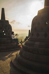 Taking a shot (Syahrel Azha Hashim) Tags: sonyimages expression tourist indonesia structure wonders simple morning 2017 details borobudur dramaticsky architecture texture moment 35mm temple placeofworship dof holiday clouds touristattraction building people shades sonya7 oneperson handheld sony colorimage vacation destination prime light a7ii naturallight bellshaped colorful ilce7m2 beautiful travel syahrel getaway shallow colors sunrise unesco heritage jogjakarta detail
