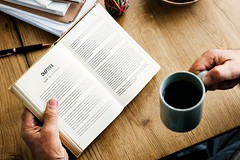 Study with coffee (Wallboat) Tags: book boy chapter coffee commoncreativeimages cup freeimages freephotos guy hand knowledge man mug notepad pen read royaltyfree study table