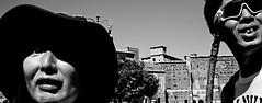 So much to see. (Baz 120) Tags: candid candidstreet candidportrait city candidface candidphotography contrast street streetphoto streetcandid streetphotography streetphotograph streetportrait rome roma romepeople romestreets romecandid europe monochrome monotone mono blackandwhite bw noiretblanc urban voigtlandercolorskopar21mmf40 voightlander leicam8 leica life primelens portrait people unposed italy italia girl grittystreetphotography faces decisivemoment strangers