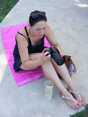New toy...... (sean and nina) Tags: nina camera nikon new pink towel seated sitting sun bathing summer august 2017 petrinja croatia croatian serb hrvatska feet toes sandals legs arms tan tanned bare skin shoulders neck throat face lips brown eyes brunette hair dark sunglasses woman female girl lady girlfriend fiancee wife married beauty beautiful gorgeous stunning charm charming concentrating photographer candid outside outdoors people person public petrinjcica blue dress balkan balkans unposed