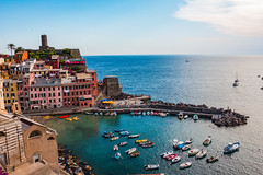 The Beautiful View of the Vernazza Port and the Vast Blue Mediterranean Sea on a Sunny Day, Cinque Terre, Italy (MedCruiseGuide.com) Tags: vernazzaport vernazzaoldtown vernazza vernazzacinqueterreitaly cinqueterre colorfulhouses 5terre colors coast cinqueterrevillage cinqueterrebeaches cityview cinqueterreitaly cinqueterrevillages oldtown holiday houses hills summer sky summervacation bluesky bluesea sea beach buildings boats colorfulboats port outdoors travel tourism italia italy italianvacation view beautifulview beachday beachfun fun water sunbathing swimming sunnyday hiking cinqueterrehiking