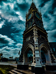Gold Rims (Steve Taylor (Photography)) Tags: christchurch canterbury southisland nz newzealand clock tower victoriast diamondjubilee clocktower volcanicstone limestone queenvictoria jubilee glass stained art vintage memorial architecture digital contrast blue brown black gold green city perspective autumn cloud sky stormy moody