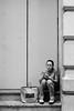 Smoke and Text Break (cbrady.brady94) Tags: bw ilfordhp5 film 50mm smoking smoke break iphone sitting candid streetphotography woman city citylife philadelphia