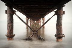 Under the bridge (Tilemachos Papadopoulos) Tags: qoq wet rust fujifilm infrastructure outdoor architecture abstract sky structure sea decay diagonal fuji greece horizon lines landscape xe2 vanishingpoint mirrorless bridge