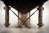 Under the bridge (Tilemachos Papadopoulos) Tags: qoq wet rust fujifilm infrastructure outdoor architecture abstract sky structure sea decay diagonal fuji greece horizon lines landscape xe2 vanishingpoint mirrorless bridge