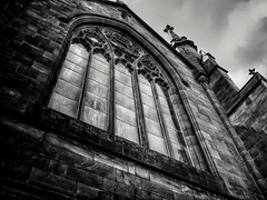 Different Perspective (GLKPhotos) Tags: cathedral church window glass ornate stonemasonry brick mortar steeple old architecture oldbuilding historical contrast textures details blackandwhite monochrome ulster northernireland uncropped gargoyle perspective dark gothic atmospheric