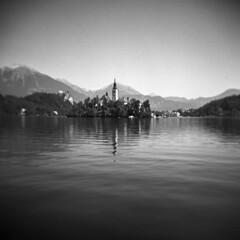 Lake Bled (Blurmageddon) Tags: mediumformat film analogphotography 6x6 holga120gcfn tmy400 tmax400 kodak rodinal semistand standdeveloped blackandwhite europe travel vacation epsonv700 toycamera plasticfantastic lakebled slovenia