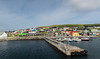 The colourful houses of Nolsoy (Ralph Green) Tags: faroeislands nólsoy boats harbour houses wharf windturbine