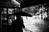 Patience (ewitsoe) Tags: france paris canon 50mm street city weather rain raining umbrella monochrome blackandwhite vibe vibes staydry dry wet summer cityscape ewitsoe eso5ds urban man bw