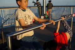 Gymnastics (dtanist) Tags: nyc newyork newyorkcity new york city sony a7 konica hexanon 40mm brooklyn coney island boardwalk steeplechase pier gymnastics children kids play playing sea bar
