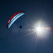 Paragliding in font of the sun