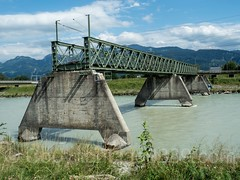 RHE231 Industriegleis Railroad Bridge over the Alpenrhein River, Kriessern SG Switzerland - Mäder Austria (jag9889) Tags: 2017 20170805 at aut abandoned alpenrhein alpinerhine austria border bridge bridges bruecke brücke ch cantonstgallen closed crossing europe feldkirch fluss helvetia infrastructure kantonstgallen kriessern mäder oberriet oesterreich outdoor pont ponte puente punt railoadbridge rein reno republic rhein rheintal rhin rhine rhinevalley rijn river sg sanktgallen schweiz span strom structure suisse suiza suizra svizzera swiss switzerland truss vorarlberg wasser water waterway jag9889