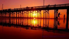 Don't Let The Sun Go Down On Me......... (law_keven) Tags: sunset usa america water ocean pacificocean piers newportbeach newportbeachpier sun orange reds orangecounty photography landscapephotography silhouettes