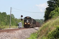 "A trio of Illinois Central SD70s blast South passed ""RX"" in Albion, PA. (u18b404) Tags: ic sd70 emd 1034 1018 1038 bessemer lake erie ble"