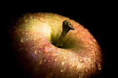 An Apple a Day..... (DarrenCowley) Tags: macromondays stayhealthy macro apple fruit stilllife water droplets red darrencowley canon5d blackbackground stem nutritious natural inviting