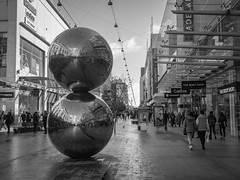 Mall's Balls (Anthony Kernich Photo) Tags: adelaide australia south southaustralia sa city rundlemall mall shopping walkway pedestrian shoppingstrip sculpture art publicart public location attraction metal bw mono grayscale blackandwhite olympus omd microfourthirds ruleofthirds photo scene streetphotography bertflugelman sphere stainlesssteel geometric geometricart abstract abstractart photography streetscape