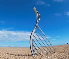 Norman Longboat on Hastings Beach (Rhisiart ap Someone) Tags: england gbr hastings unitedkingdom beach pier hastingspier longboat normans sculpture artwork 1066