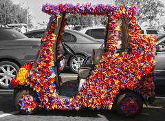 Rush Hour in Sun City West, Arizona (oybay©) Tags: color colors streamers golfcart golf cart golfcar car colorful colores colour shopping supermarket lot subtle notsubtle noyoudriveit