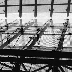 Stage of Glass (Thomas Listl) Tags: thomaslistl blackandwhite noiretblanc biancoenegro graphical geometry abstract glass lines stripes square 50mm roof architecture