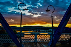 Framed Sunset. Framed. (Roland 22) Tags: chattanooga tennessee walnutstreetbridge sky clouds horizon red orange blue sunset gray reflection tennesseeriver flickr
