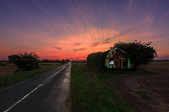 A Cooling Summer Breeze (Pete 5D...©...) Tags: summer sunset dusk evening road barn old dilapidated cooling kent england skies sky pink leading line lines corrugated metal tarmac twilight