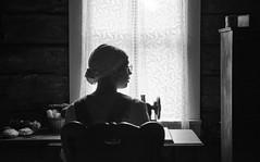Sewing By Window Light  by Tom Jenz (TomJenzAmerica.com) Tags: woman portrait people monochrome window windowlight shadow silhouette finearts backlighting sewing curtain tomjenzamerica