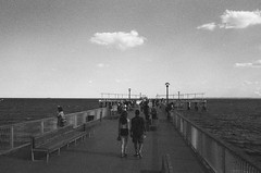 Late of the Pier (Magnus Bergström) Tags: 123bw city york new newyorkcity nyc united states america usa unitedstates streetphotography street monochrome canon ae1 kodak bw400cn expired 135 film 35mm analog bw kodakbw400cn blackandwhite blackwhite black white brooklyn coney island amusement park pier ocean atlantic