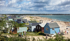 Homes, by the Sea (clive_metcalfe) Tags: hengistburyhead christchurch bournemouth dorset hut clouds sand people ocean harbour uk south