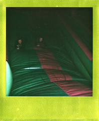 Bouncy castle (esmeelily) Tags: polaroid one600 instant impossible project poalroids metallic frame analog analogue film is dead funfair youth grunge colour vibrant neon fairground