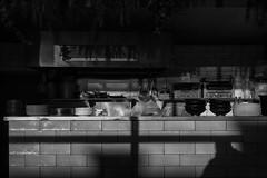 richmond-8579-bw-ps-w (pw-pix) Tags: shade shadowed dark sun sunlight shadows plants hanging vent hood rangehood splashback stainlesssteel cooker grills grill shelf kitchen utensils pots pans plates counter bowls wood tiles tiled restaurant jethro closed outofhours lateafternoon burnleystreet richmond easternsuburbs innersuburbs melbourne victoria australia