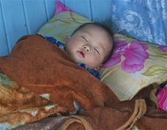 Hue, Vietnam (spideysmom10) Tags: vietnam hue perfumeriver dragonboat nikond3100 seasia southeastasia sleep motherandchild portrait