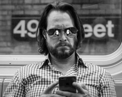 Double Take (John St John Photography) Tags: streetphotography candidphotography ntrain 49th street subwaystation mta newyorkcity newyork man mobile cell smartphone sunglasses reflections symmetry peopleofnewyork beard bw blackandwhite blackwhite blackwhitephotos johnstjohn