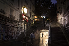 Paris metro (Michel Couprie) Tags: france paris metro night nuit street streetlamp light composition rain stairs escalier montmartre lamarckcaulaincourt canon couprie eos tse24mmf35l people contrejour contrast