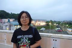 Naomi Over the Train Tracks (sjrankin) Tags: 5august2017 edited yubari hokkaido japan people yubarisummerfestival yubarinatsumatsuri shimizusawa family naomi