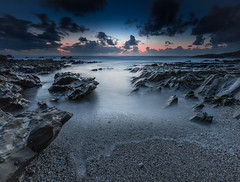 Surreal Sunset (Mick Blakey) Tags: shoreline slowexposure sand sunset cornish water clouds shadows blue beach cornwall coastal blueskies rocks twilight towanhead pebbles seascape dusk coast sea rocky